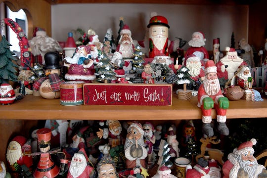 Phyllis and Dave Bryan have a collection of Santa figurines which decorate their Wayneville home year-round. Dave had started the collection before he and Phyllis were married.