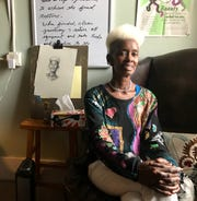 Jeanette King sits in the artist's studio at Haywood Street Congregation by her sketch to be used in the fresco. King is a member and works at Haywood Street and says the church saved her life.