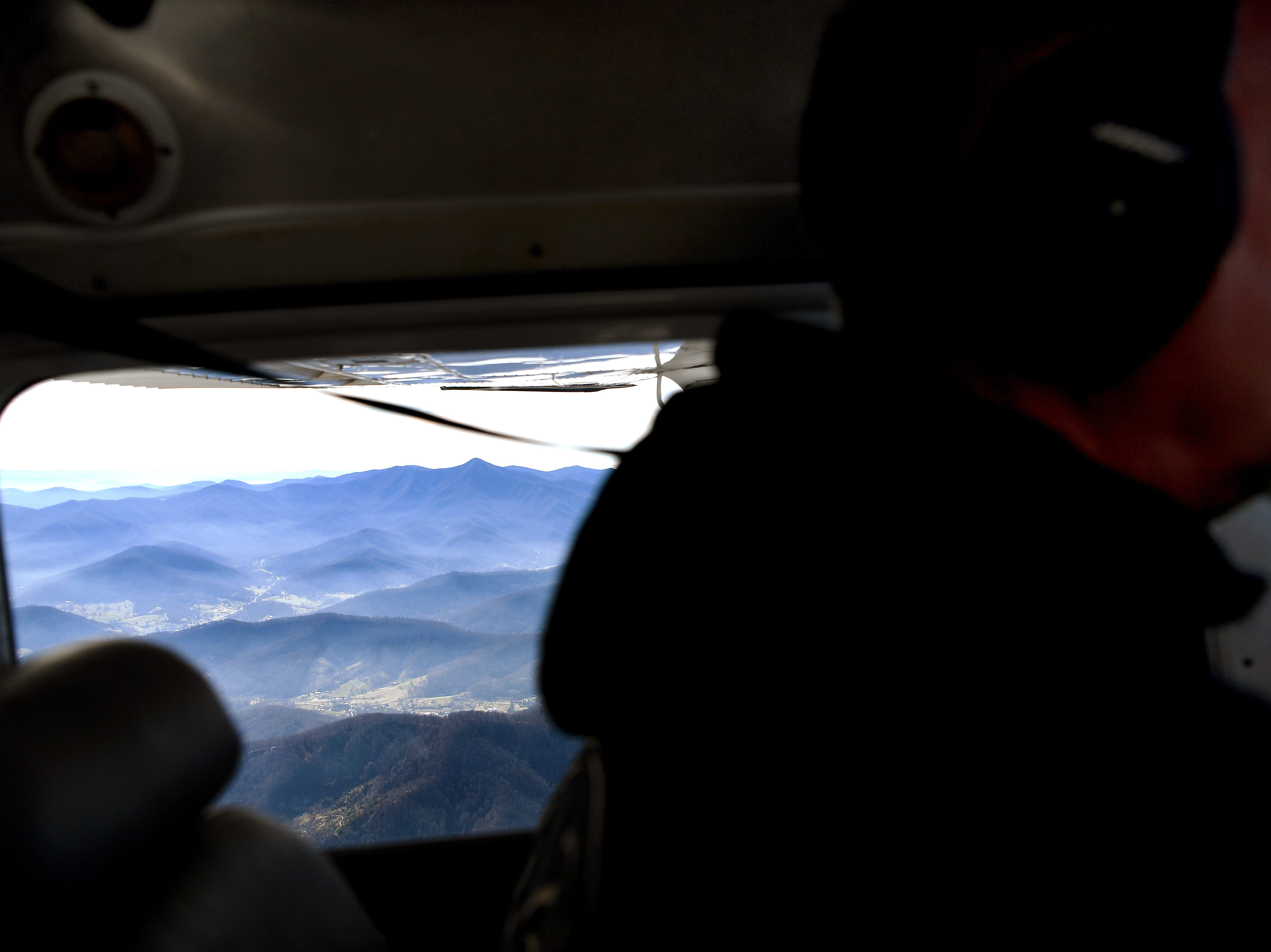 Pilot Hap Endler flies his 1972 Cessna 182P, a fixed-wing single-engine airplane, toward the North Carolina border with Tennessee from the Asheville Regional Airport on Dec. 6, 2018. Endler is a volunteer pilot with SouthWings, a non-profit conservation organization that uses flight for ecosystem and biodiversity advocacy. Photo made possible by SouthWings.