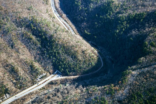 An I-40 tunnel through the mountain near the North Carolina border with Tennessee is seen from the air on Dec. 6, 2018. Photo made possible by SouthWings.