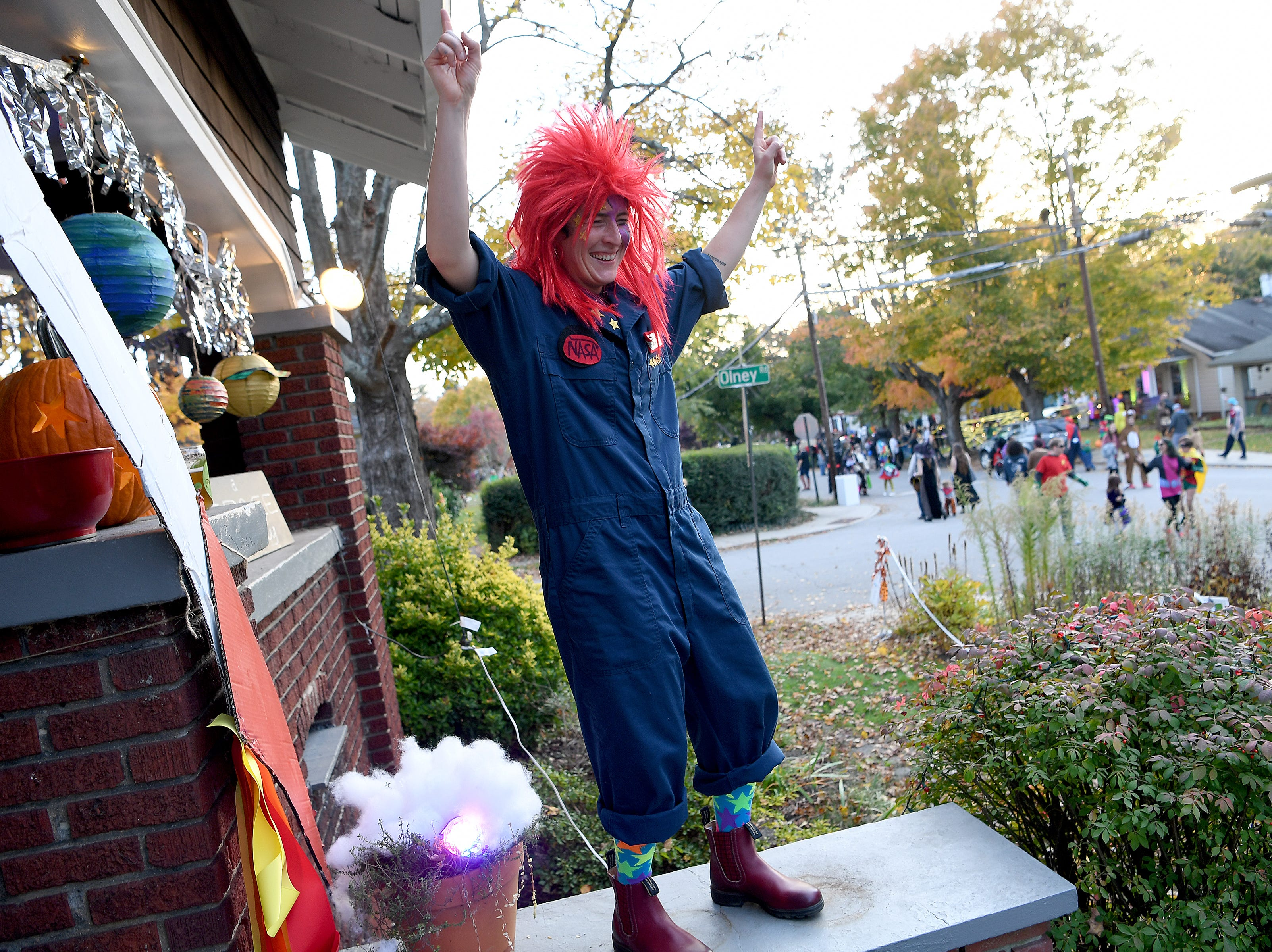 Fynn Crooks dances on the front porch of a spaceship as trick-or-treaters make their way up and down Vermont Avenue for the street's annual Halloween celebration on Oct. 31, 2018.