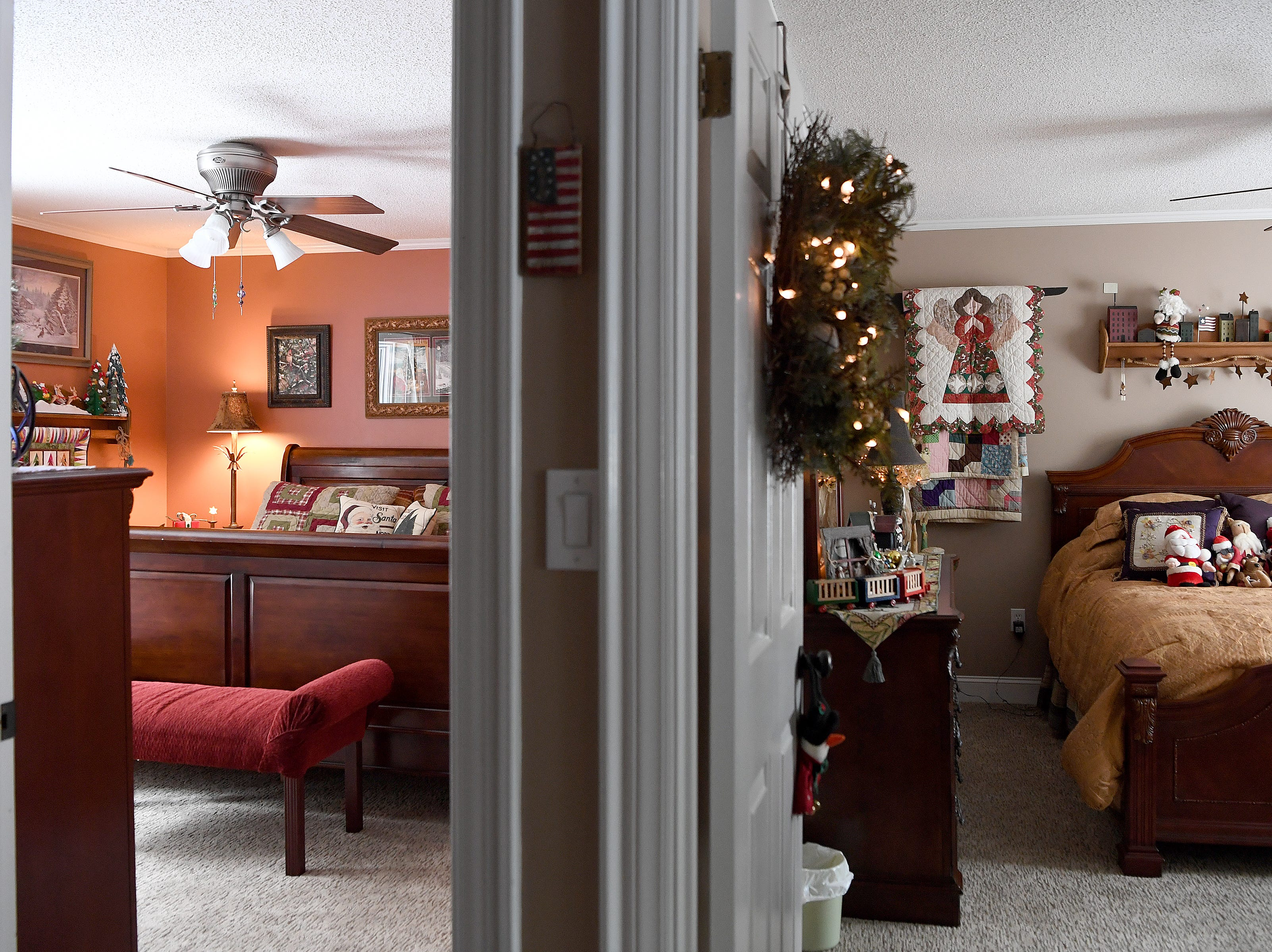 "Both guest rooms of the Bryans' are decorated for Christmas with toys and wall hangings filling the rooms. The  ""Sleigh Room,"" left, is decorated year-round."