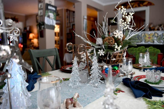 The dining room table in the Bryans' Waynesville home is elaborately set for the holidays. Phyllis Bryan wove the table runner herself.