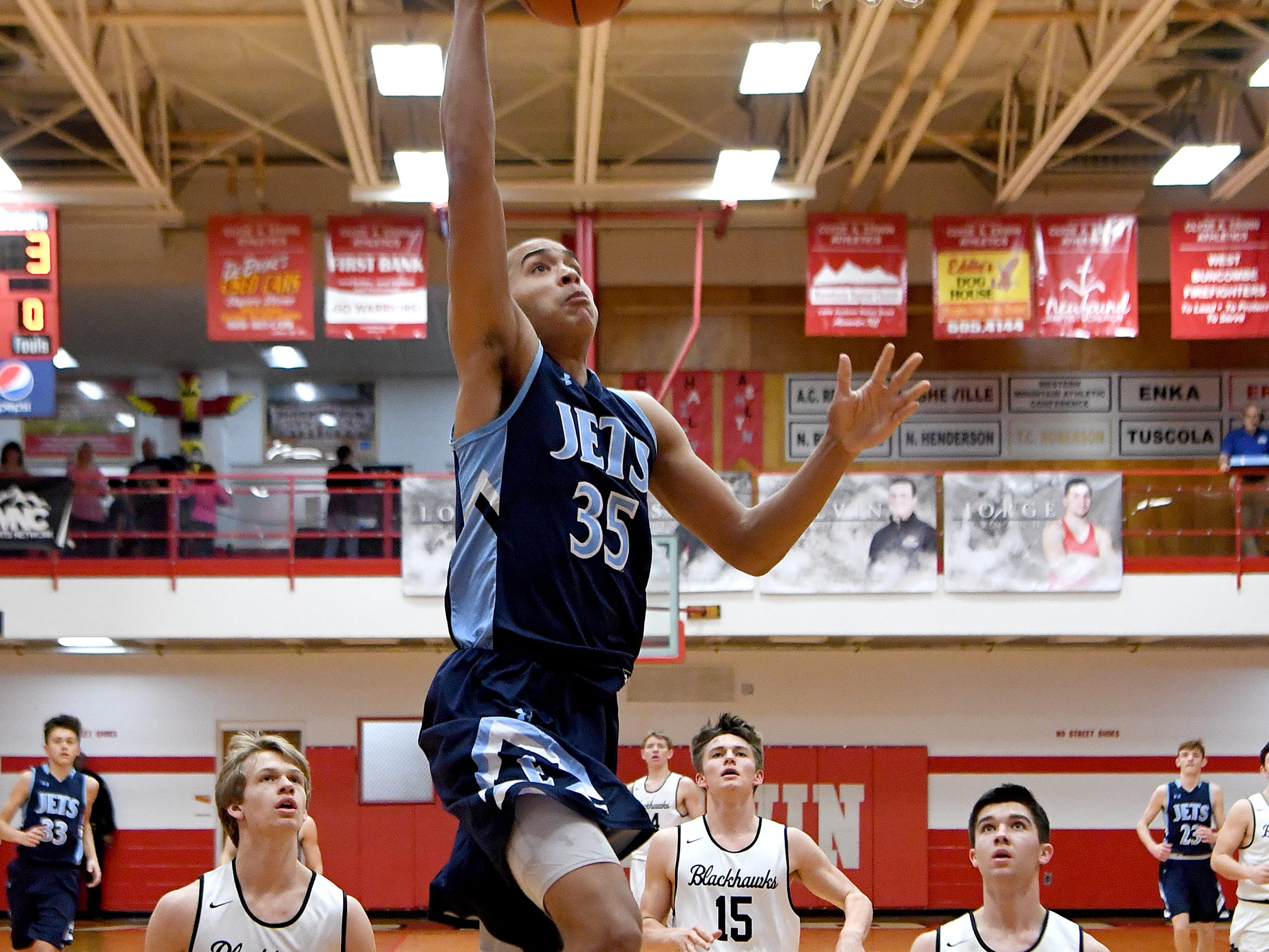 Enka's Joshua Walton goes up for a shot against North Buncombe during the semi-final round of the WMAC tournament at Erwin High School on Wednesday, Feb. 14, 2018.