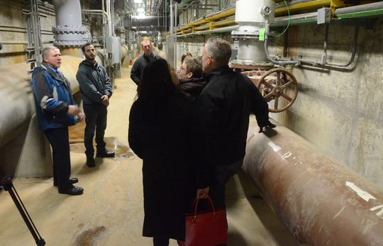 Rich Beardslee, wastewater treatment plant superintendent, explains the process during a tour of the River Road plant.