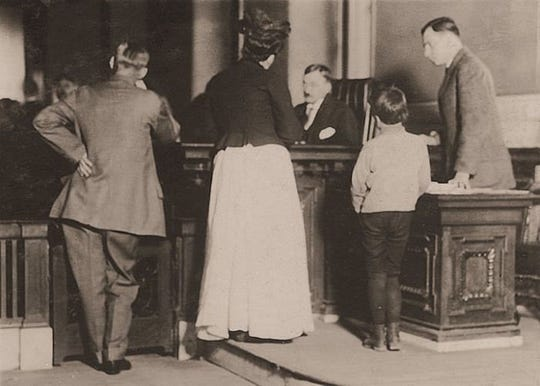 An early photograph of a Children's Court proceeding, about 1910.