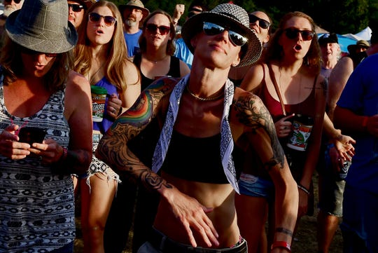 Festival goers dance to the music of the Empire Kings during the Finger Lakes GrassRoots Festival of Music and Dance on Friday, July 20, 2018, in Trumansburg, NY.