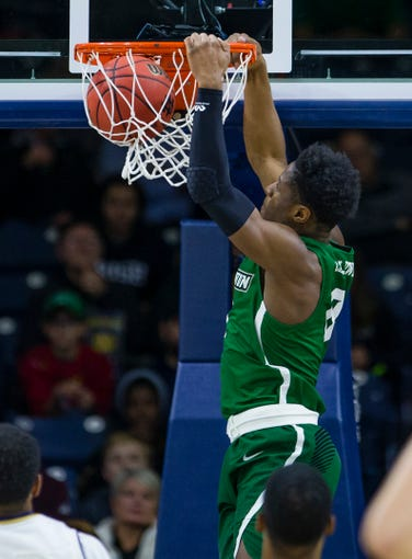 Binghamton's Richard Caldwell, Jr. (0) dunks during an NCAA college basketball game against Notre Dame Tuesday, Dec. 18, 2018 in South Bend, Ind. (Michael Caterina/South Bend Tribune via AP)