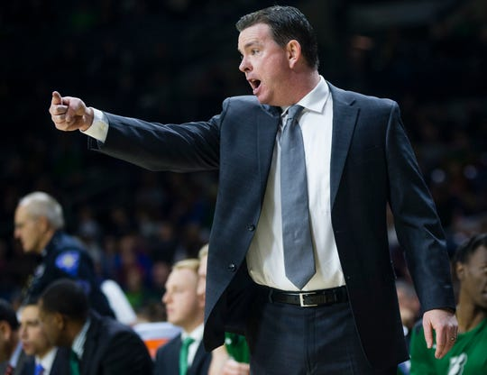 Binghamton head coach Tommy Dempsey calls out a play during an NCAA college basketball game against Notre Dame, Tuesday, Dec. 18, 2018 in South Bend, Ind.. (Michael Caterina/South Bend Tribune via AP)