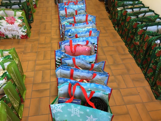 Elementary School studnets attending Union-Endicott High School's holiday party received a customized bag of toys.
