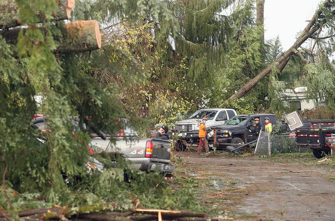 Residents and work crews clean up the aftermath of Tuesday's tornado on Serenade Way in Port Orchard on Thursday, December 20, 2018.