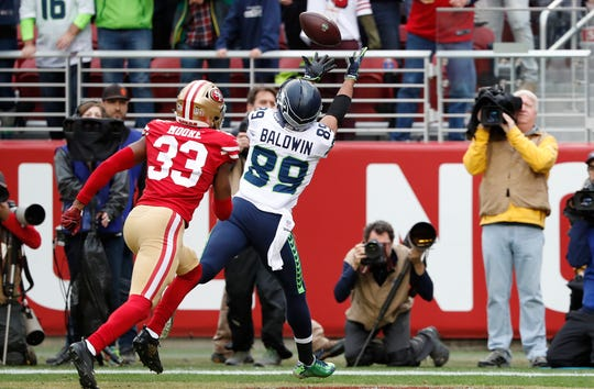 Doug Baldwin reaches out for one of his two touchdown passes on Sunday against San Francisco.
