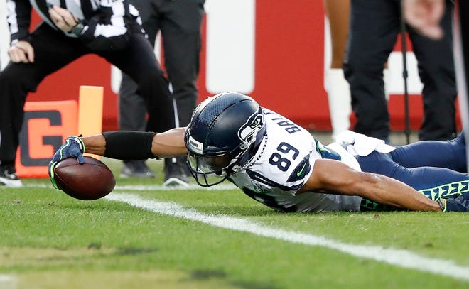 Seahawks wide receiver Doug Baldwin stretches to score one of his two touchdowns against the San Francisco 49ers on Sunday.