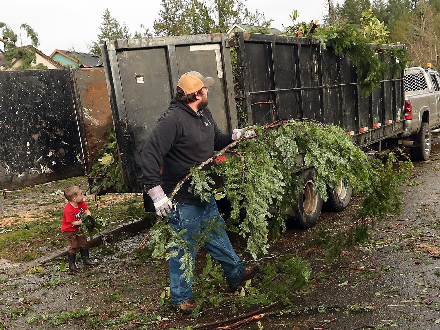 Residents and work crews clean up the aftermath of Tuesday's tornado in the neighborhoods along Harris Road SE in Port Orchard on Wednesday, December 19, 2018.