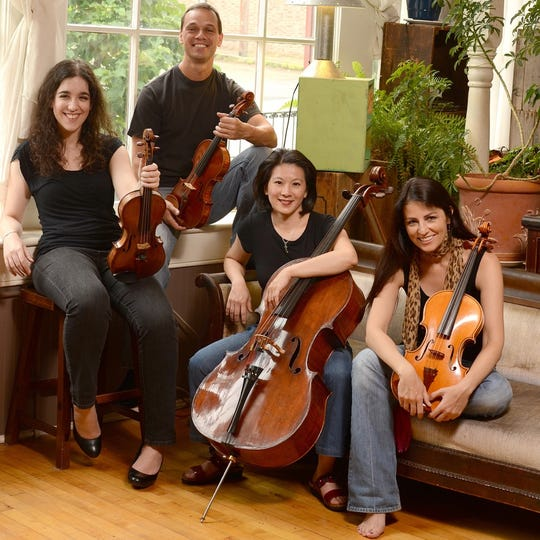 """Concerts in the Barn"" are back in Quilcene in July, featuring the Carpe Diem String Quartet: Amy Galluzzo (from left), Charles Wetherbee, Carol Ou and Korine Fujiwara."