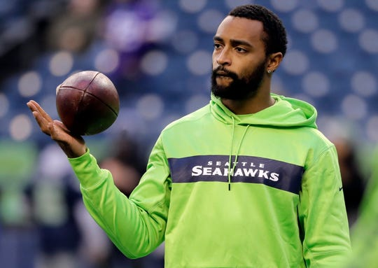 Doug Baldwin looks on during warm-up before a game against Minnesota in 2018. The outspoken Seahawks receiver is likely done playing football, but odds are we will still hear from him.
