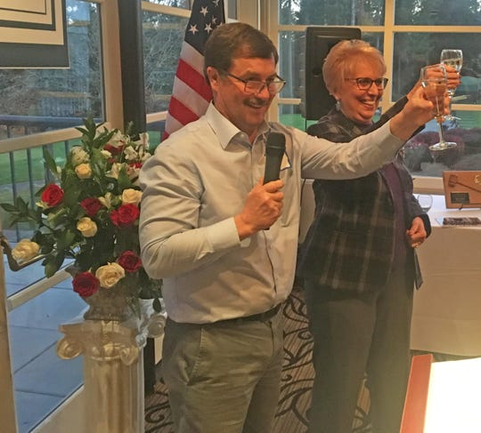 Sen. Jan Angel, R-Port Orchard, toasts with Sen. Mark Schoesler, R-Ritzville, at a celebration of her career Nov. 18 at Canterwood Golf and Country Club in Gig Harbor. Angel retired at the end of the 2018 legislative session after 20 years in politics. Angel served as a Kitsap County commissioner and as representative for the 26th Legislative District before her election to the 26th District Senate seat in 2013.