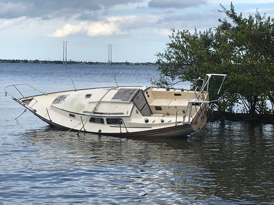 Seven derelict boats, including this one near Castaway Point Park in Palm Bay, will be removed from waterways, with a $48,500 Tourism + Lagoon Grant.