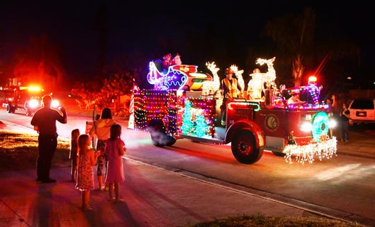 On Wednesday night the Indian Harbour Beach Volunteer Fire Department, with Pumper Truck 56 all decked out with Christmas lights, Santa's sleigh and Santa Claus himself, made its way through some neighborhoods passing out candy and an occasional fire hat to kids on the sidewalk, escorted by fire vehicles with blinking lights flashing and sirens blaring.