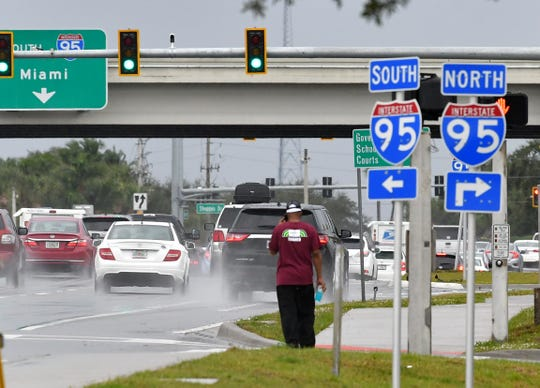 Rain soaked Wickham Road near 1-95 in Viera. Rainy conditions were expected to persist for the week in most of Brevard County.