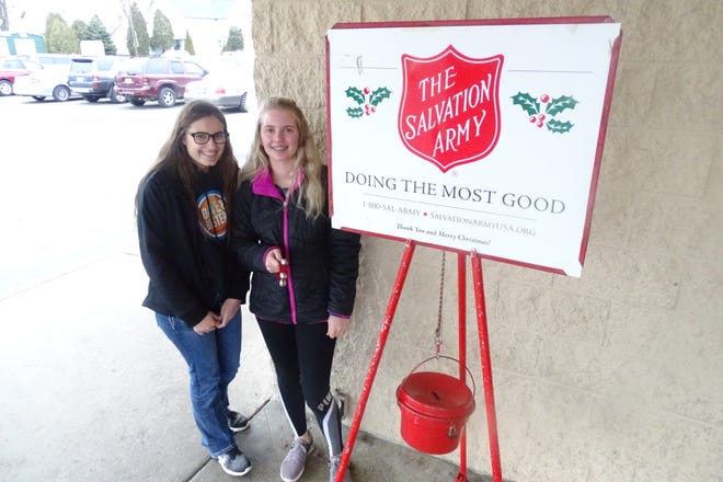 Shelbi Dilgard, left, and Katie Tuck, both sophomores from Wynford High School, ring the Salvation Army bell Thursday afternoon outside the Bucyrus Kroger.