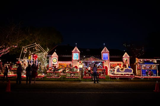 Residents come out to look at Mr. Bill's Christmas decorations at his home on Hampton Street on Wednesday, Dec. 19, 2018. For 20 years Mr. Bill has decorated his home with an elaborate display of Christmas decorations.