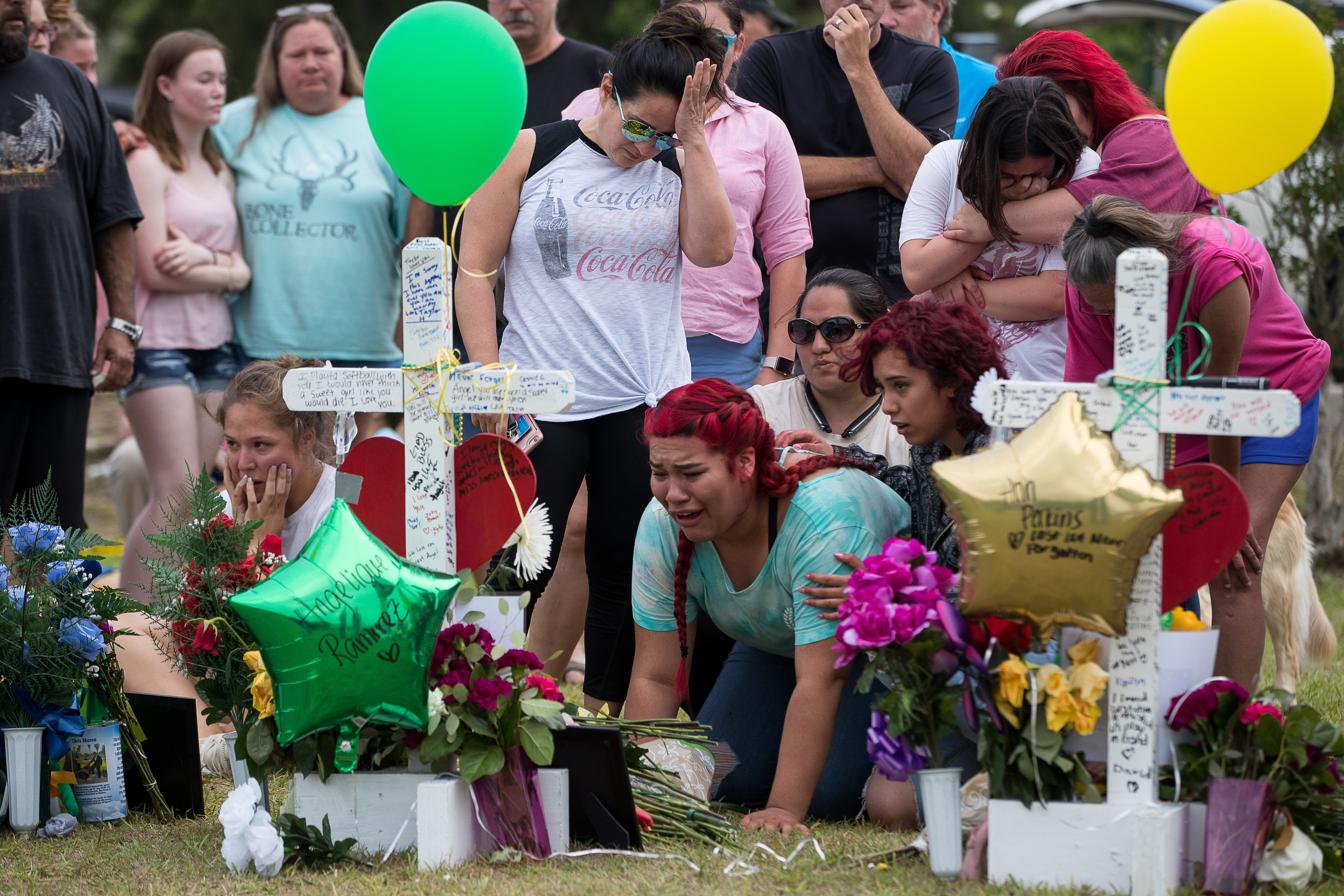 Mourners visit a makeshift memorial outside Santa Fe High School after a 2018 mass shooting that left 10 dead.
