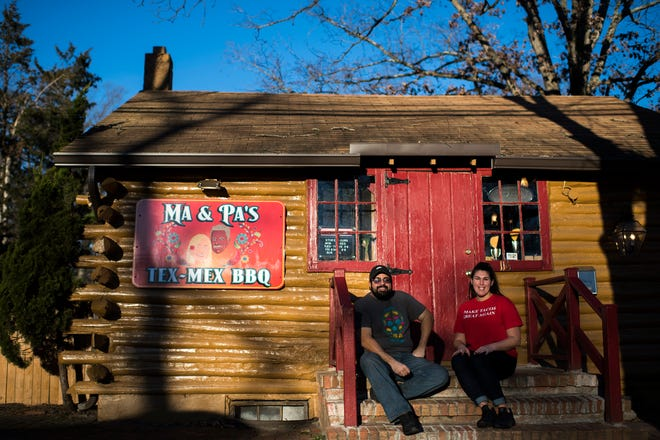 Ma & Pa's Tex-Mex BBQ owner and founder Alex Martinez, left, sits on the steps of the newly-opened Mount Laurel restaurant with Sarah Marsh, his business partner at the establishment.