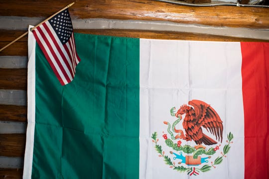 A Mexican and American flag hangs inside Ma & Pa's Tex-Mex BBQ in Mount Laurel.