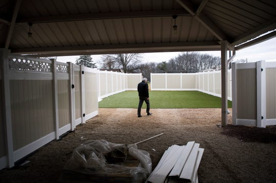 Owner Andy Hennig walks along an outdoor area at the upcoming K9 Resorts Daycare & Luxury Hotel Thursday, Dec. 20, 2018 in Cherry Hill, N.J.
