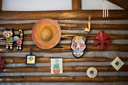 Festive Mexican-themed decor hangs on the walls of Ma's & Pa's Tex-Mex BBQ in Mount Laurel.