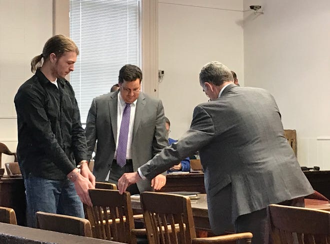 "Edward ""Jake"" Wagner, left, prepares to sit down for his first of many pretrials in Pike County Common Pleas Court on Dec. 20, 2018."