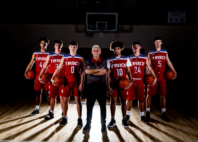 Zane Trace basketball players (L-R) junior Triton Davidson, junior Luke Johnson, junior Colby Swain, coach Gary Kellough, junior Cam Evans, senior Chad Ison, and junior Nick Nesser.