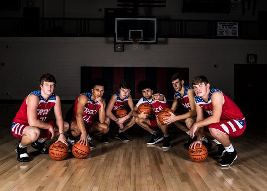 Zane Trace basketball players (L-R) junior Luke Johnson, junior Triton Davidson, junior Colby Swain, junior Cam Evans, junior Nick Nesser, and senior Chad Ison.