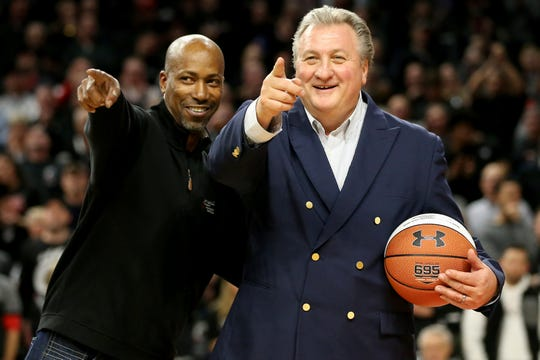Former Cincinnati Bearcats player Tarrice Gibson, left, and former Cincinnati Bearcats Bob Huggins look at the crowd at halftime of an NCAA college basketball game, Wednesday, Dec. 19, 2018, at Fifth Third Arena in Cincinnati.