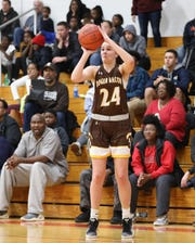 Roger Bacon guard  Kelly Brenner shoots the  ball.