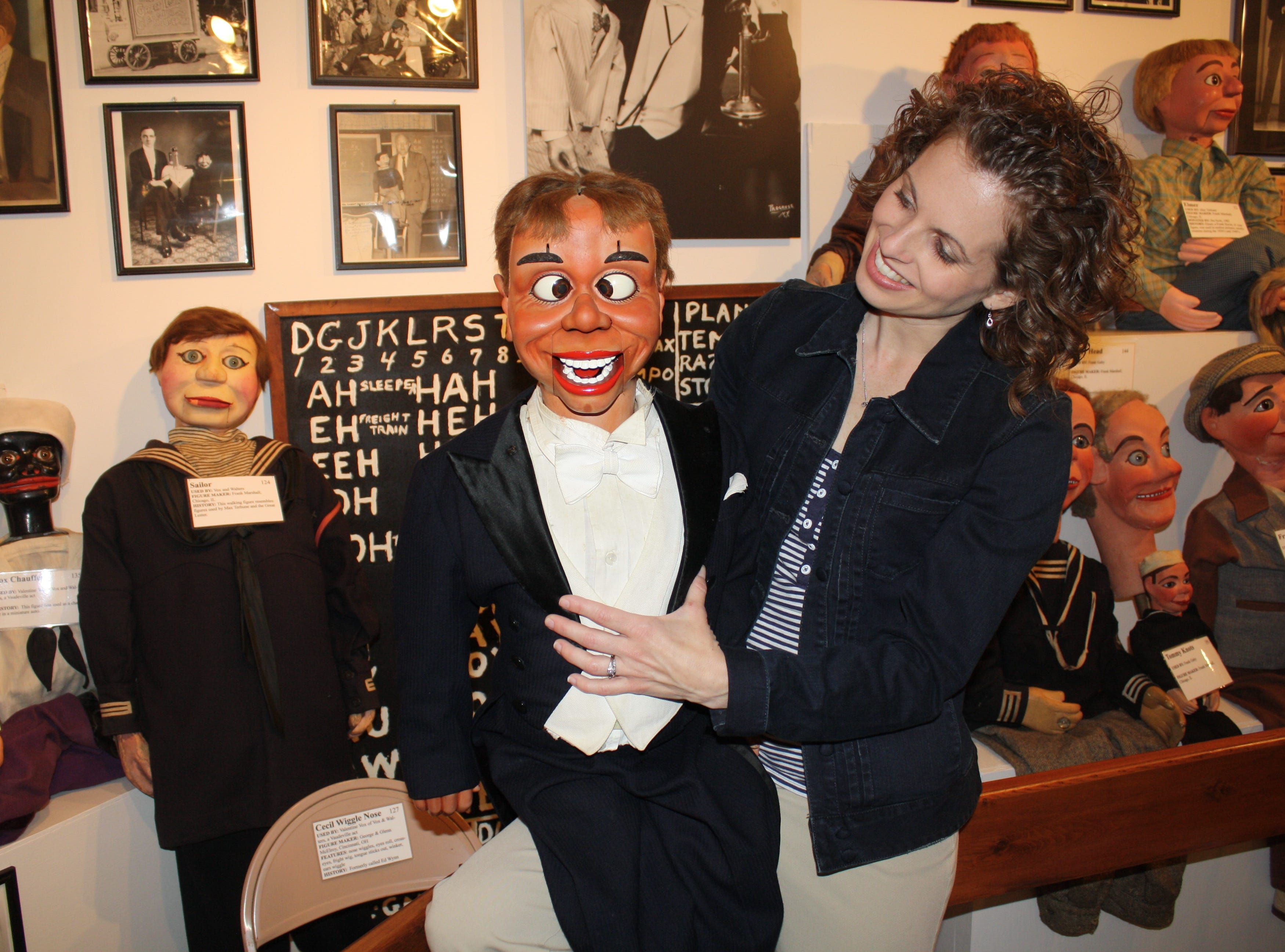 The art of ventriloquism lives on in Northern Kentucky at the Vent Haven Museum, a haven for retired ventriloquists' dummies. Jennifer Dawson, Vent Haven's former curator, sits with an intricate dummy, whose makers are from Cincinnati.