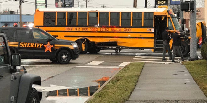 Several injuries reported at a crash between a school bus and another vehicle in Anderson Township.