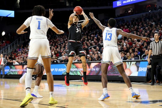 Cincinnati Bearcats guard Jarron Cumberland (34) rises for a shot in the first half of an NCAA college basketball game against the UCLA Bruins, Wednesday, Dec. 19, 2018, at Fifth Third Arena in Cincinnati.
