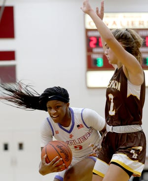 Purcell Marian guard  Amil Ali -Shakir drives to the basket against  Roger Bacon guard Kylee Sheppard.