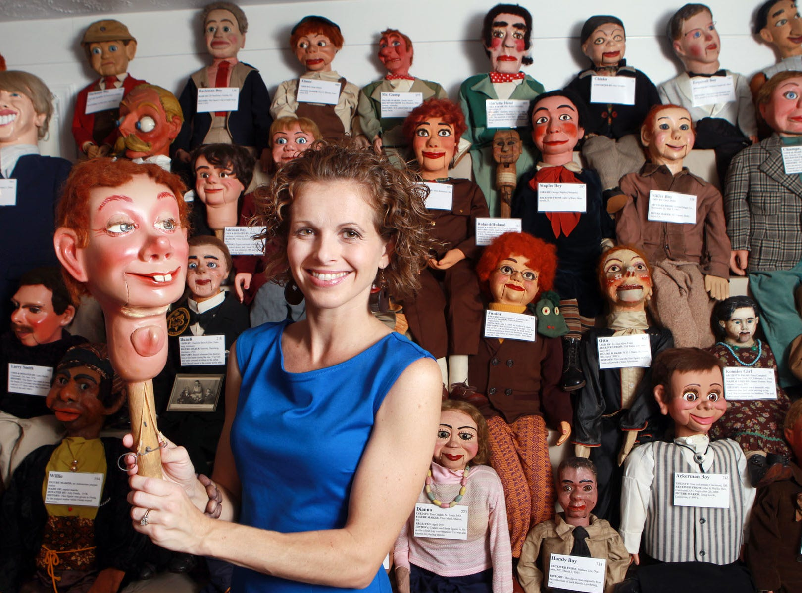 Jennifer Dawson, former curator of the Vent Haven Museum in Fort Mitchell, with the head of a figure  used early in his career by actor Ted Knight.