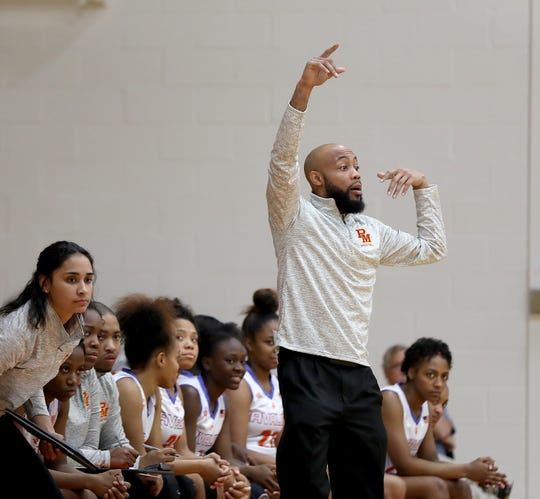 Purcell Marian head coach Jamar Mosley during the Cavaliers  basketball game against Roger Bacon.
