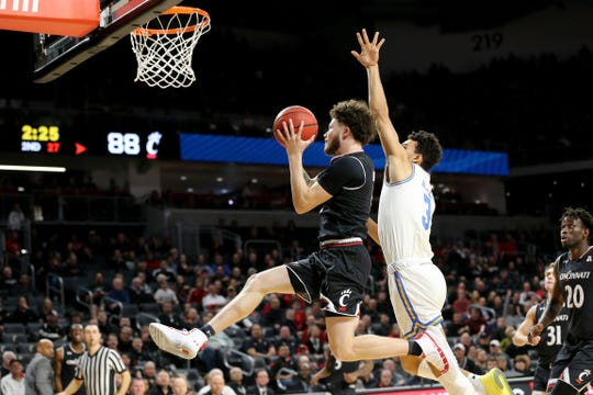 Cincinnati Bearcats guard Logan Johnson (0) drives to the basket in the second half of an NCAA college basketball game against the UCLA Bruins, Wednesday, Dec. 19, 2018, at Fifth Third Arena in Cincinnati. Cincinnati Bearcats won 93-64.
