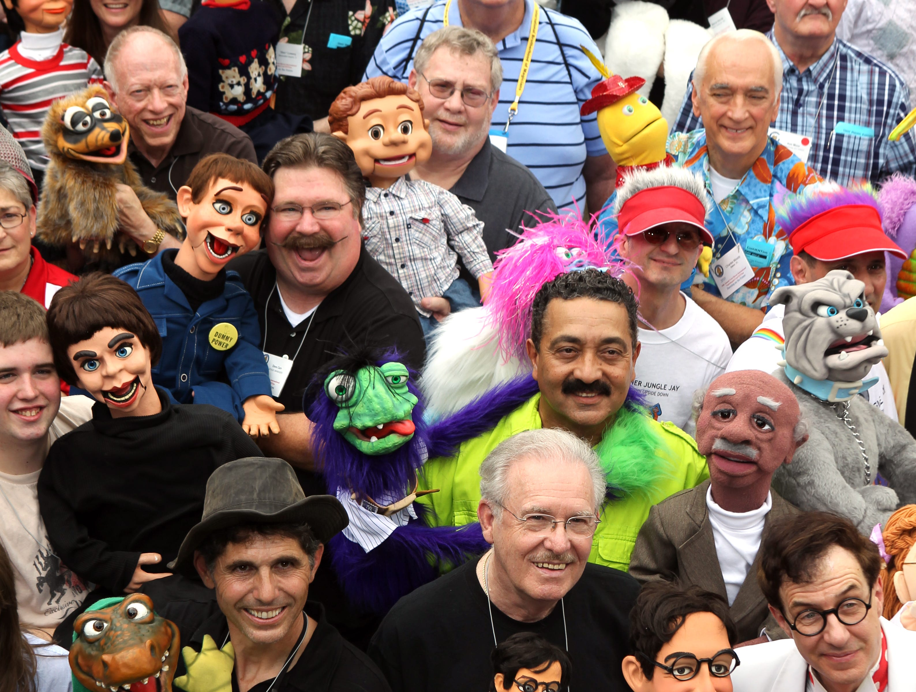 Ventriloquists and their puppets gather at the Drawbridge Inn, Fort Mitchell, to have a group photo made as part of the 34th Annual Vent Haven International Ventriloquist ConVENTion.  More tha 400 ventriloquists from 13 countries attended.