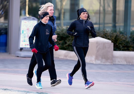 Jean Schmidt, former U.S. Representative, and attorney Michele Young run with Tyra Patterson at Washington Park in February to train for a Flying Pig race. Schmidt and Young are reentry mentors to Patterson, who served 23 years in prison for crimes she says she did not commit.
