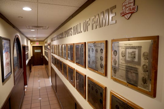 Plaques line the walls at the LaRosa's High School Sports Hall of Fame in the Westwood neighborhood of Cincinnati on Thursday, Dec. 20, 2018.
