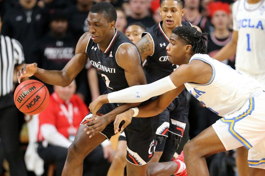 Cincinnati Bearcats guard Keith Williams (2) steals the ball in the first half of an NCAA college basketball game against the UCLA Bruins, Wednesday, Dec. 19, 2018, at Fifth Third Arena in Cincinnati.