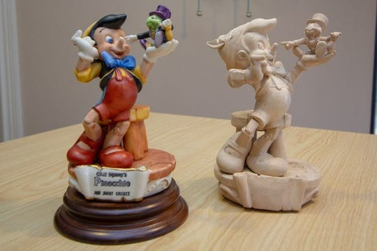 A Pinocchio painted sculpture and prototype.