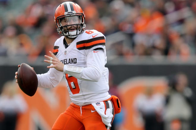 Cleveland Browns quarterback Baker Mayfield (6) rolls out of the pocket in the second quarter of an NFL Week 12 football game against the Cincinnati Bengals, Sunday, Nov. 25, 2018, at Paul Brown Stadium in Cincinnati.