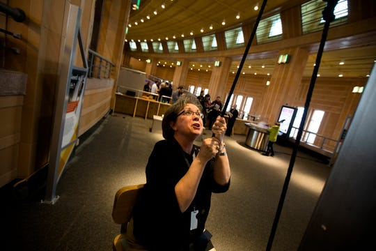 Michelle Catania lifts herself up using a pulley system at the Museum of Natural Science and History on Thursday, Dec. 20, 2018, at the Cincinnati Museum Center in Union Terminal, Cincinnati.